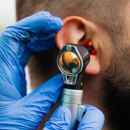 Man gets an ear exam.
