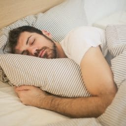 Man sleeping in a bed.